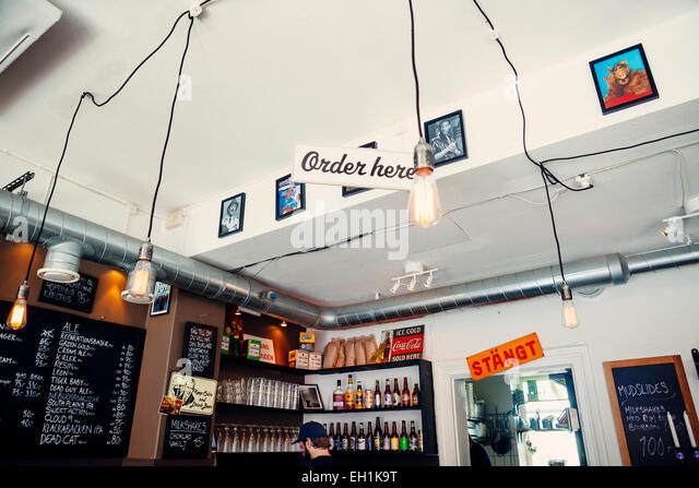 Interior of restaurant with 'order here' sign - Stock Image