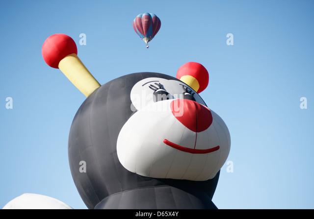 A bumblebee-shaped hot-air balloon called Lilly Little Bee in Saga International Balloon Fiesta, Saga, Japan. - Stock Image