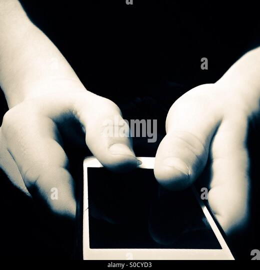 Teenager using an smartphone - Stock Image