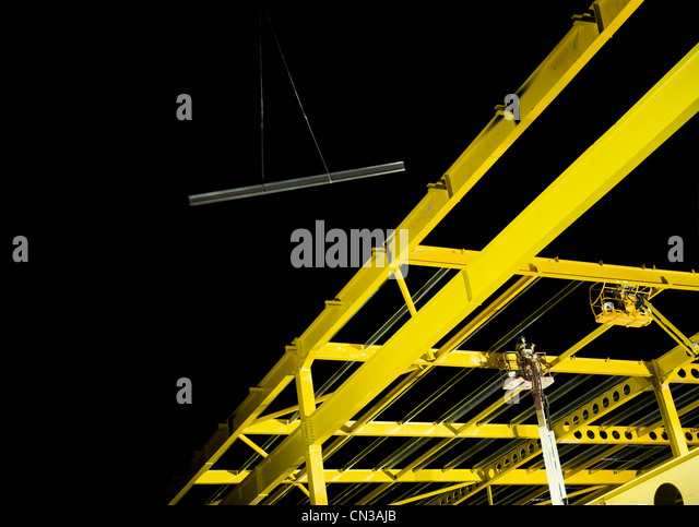 Yellow steel girder framework on construction site - Stock-Bilder