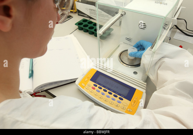 Scientist works in a Weighing Room of a Clean Laboratory on Climate Change Research. - Stock Image