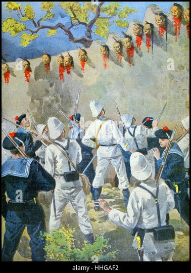 French naval and marine forces look at heads of executed Boxer rebels on the walls of Chaozhou, China. - Stock Image