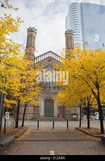 Park and the Church of the Holy Trinity in Toronto city centre - Stock Image