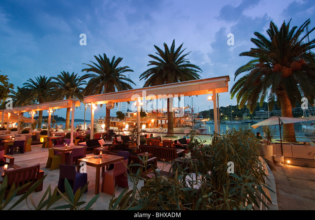 Restaurant and Bar at the Promenade of Hvar at dusk, Croatia - Stock Image
