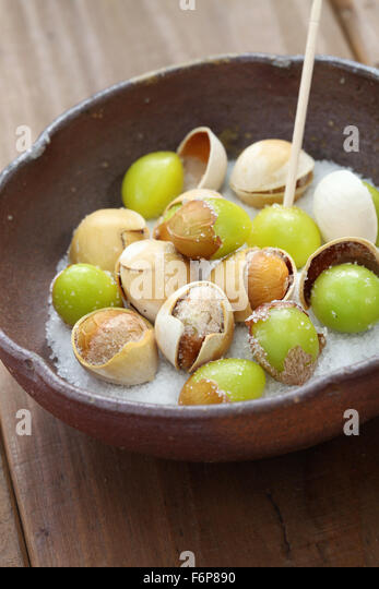 salt roasted ginkgo nuts, japanese food, close up - Stock Image