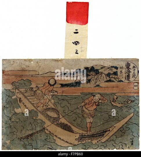 Kanagawa by Hokusai Katsushika (1706-1849). Woodcut, colour. Print of two men in a boat fishing with nets. - Stock Image
