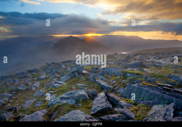 Sunset over Caher, Ireland's third highest mountain, from Carrauntoohil, MacGillycuddy's Reeks, County Kerry, - Stock-Bilder