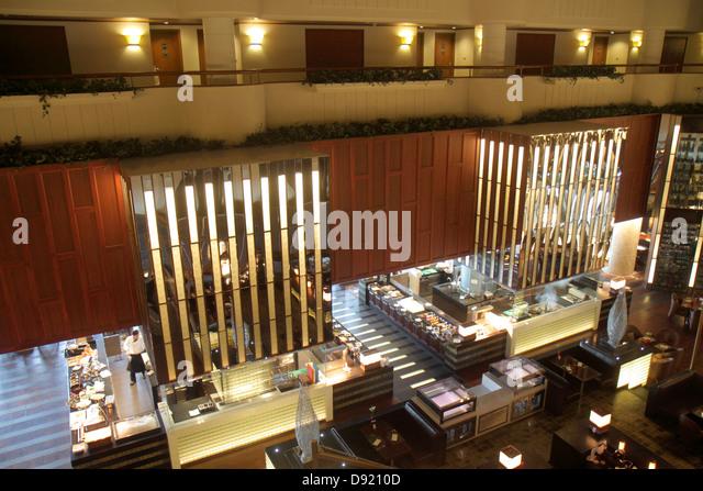 Bangkok Thailand Silom Rama IV Road Crowne Plaza Bangkok Lumpini Park atrium lobby restaurant - Stock Image