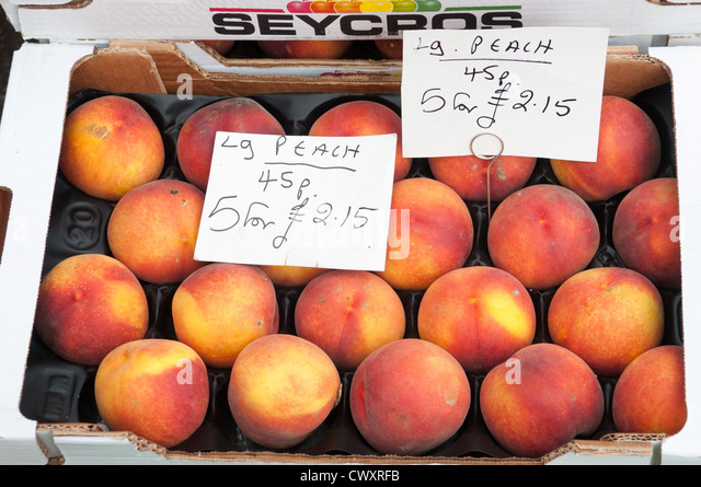 A box of peaches on sale during the Ludlow 2012 Food Festival - Stock Image