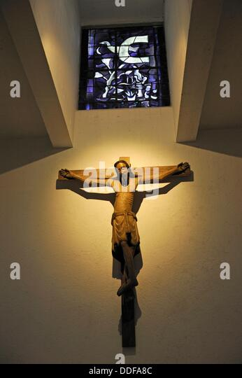 Stained-glass of G.Braque and polychrome wooden Christ from12th, Saint Bernard Chapel, Fondation - Stock Image