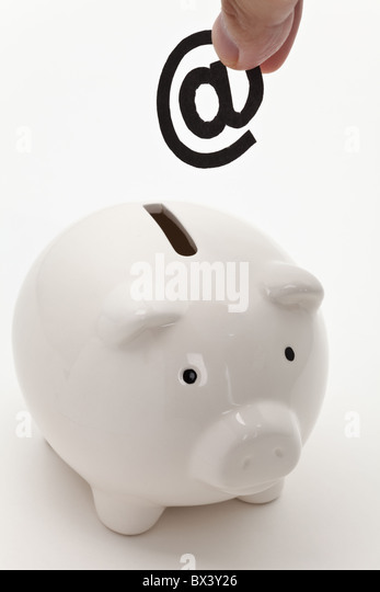 email and piggy bank, concept of E-commerce - Stock Image