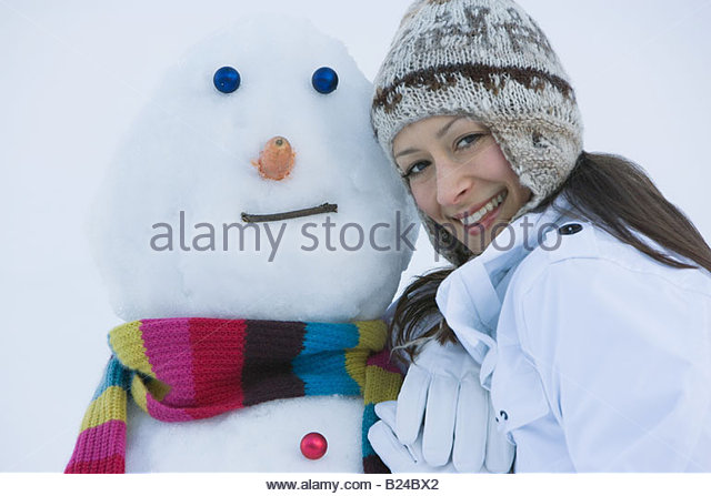 Portrait of a woman and a snowman - Stock Image