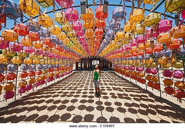 Female tourist rows lanterns honoring buddha birthday Naksansa Temple Naksansa Yangyang Gangwon province South Korea - Stock Image