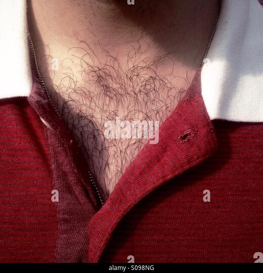 Detail of a hairy chest and red shirt - Stock Image