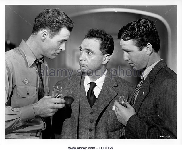 CROSSFIRE (1947) Left - Right:  Robert Ryan, Joseph Samuels, Steve Brodie. Courtesy Granamour Weems Collection. - Stock Image