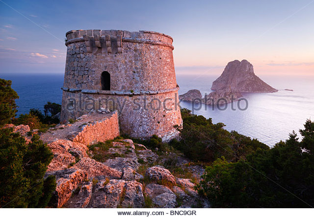 Torre des Savinar (also known as Torre del Pirata), and the islands of Es Vedranell and Es Vedrá, Ibiza Spain. - Stock Image