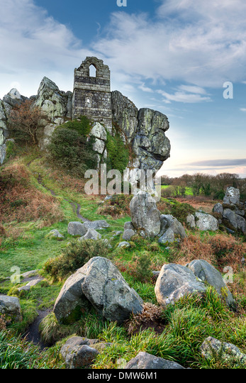 An ancient ruined chapel built in to a craggy granite tor at Roche Rock in Cornwall - Stock-Bilder