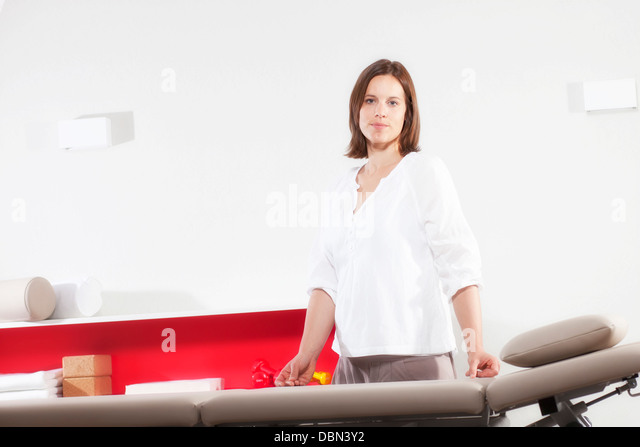Female osteopath in Physiotherapy Practice, Munich, Bavaria, Germany - Stock Image