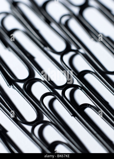 black paper clips - Stock Image