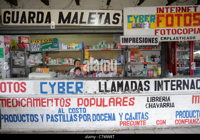 Nicaragua Managua Mercado Roberto Huembes market marketplace shopping vendor counter kiosk business drugstore sundries - Stock Image