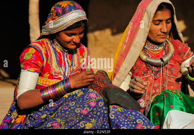 Mir tribal women with traditional attire doing embroidery work, Gujarat, India, Asia - Stock Image