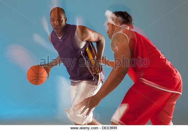 Basketball players playing basketball - Stock Image