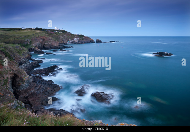 View from Lizard Point over rocky Polpeor Cove and onto the Lizard Lighthouse and old lifeboat Station, Lizard, - Stock Image