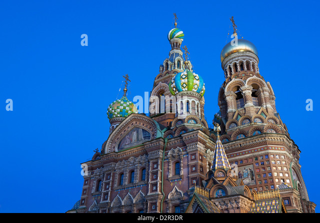 The Church on Spilled Blood illuminated at dusk, UNESCO World Heritage Site, St. Petersburg, Russia, Europe - Stock Image