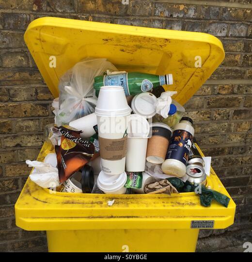 An overflowing rubbish bin - Stock Image