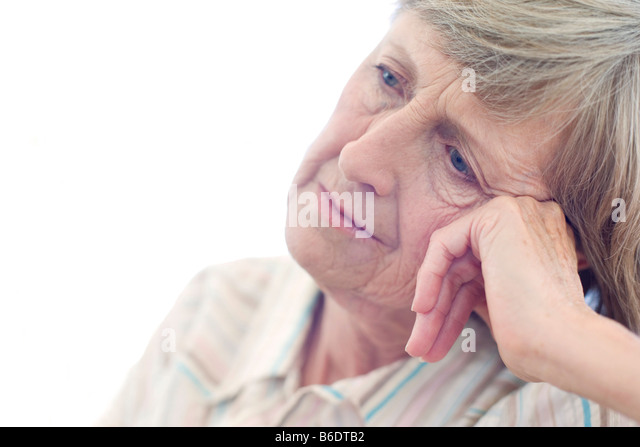 Depression. Unhappy woman resting her head on her hand. - Stock Image