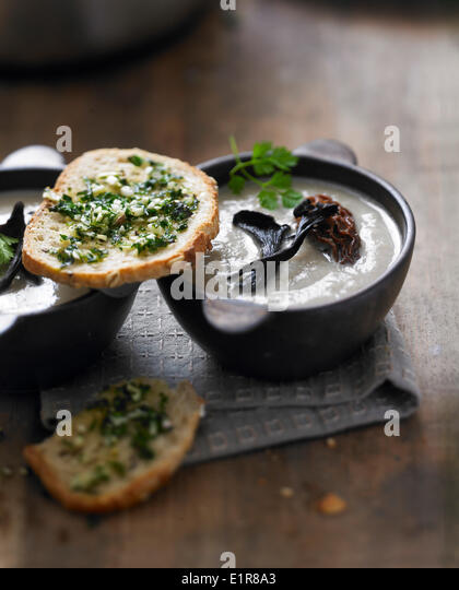 Cream of morel and black trumpet mushroom soup,parsley toasts - Stock Image