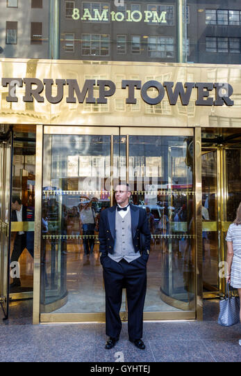 Manhattan New York City NYC NY Midtown Fifth Avenue Trump Tower entrance sign doorman job tuxedo tailcoat man young - Stock Image