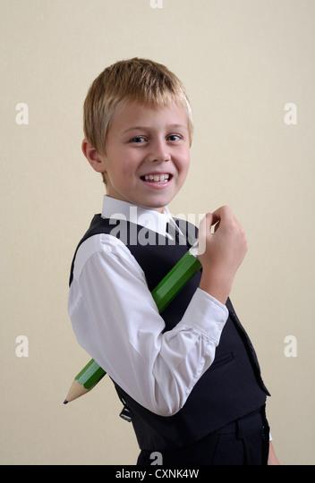 brave schoolboy with big pencil - Stock Image