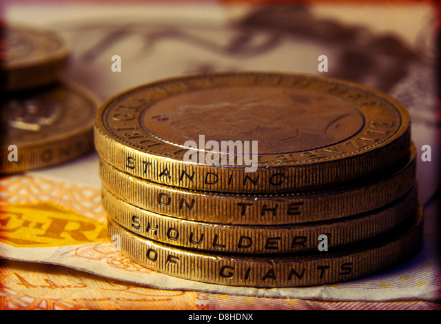 British two pound coins showing the words Standing on the shoulder of giants - Stock Image