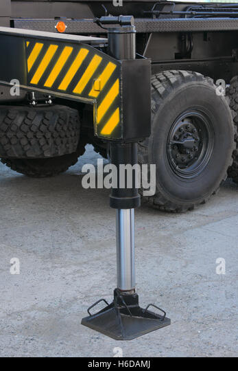 Support of the automobile elevating crane against wheels - Stock Image