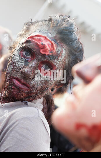 Zombies walk on the boardwalk and through the streets of Asbury Park, NJ during the annual Zombie Walk on October - Stock Image