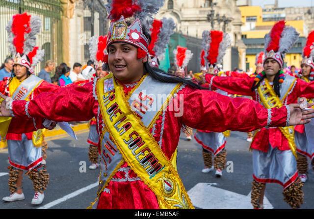 Lima, Peru.  Young Peruvian Men Marching in an Andean Cultural Parade, Plaza de Armas. - Stock Image