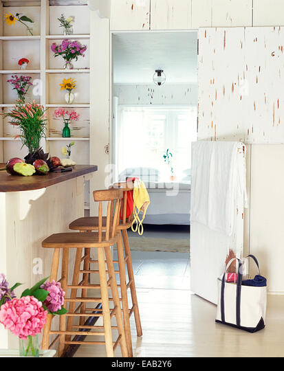 dining area and bedroom of summer bungalow - Stock-Bilder