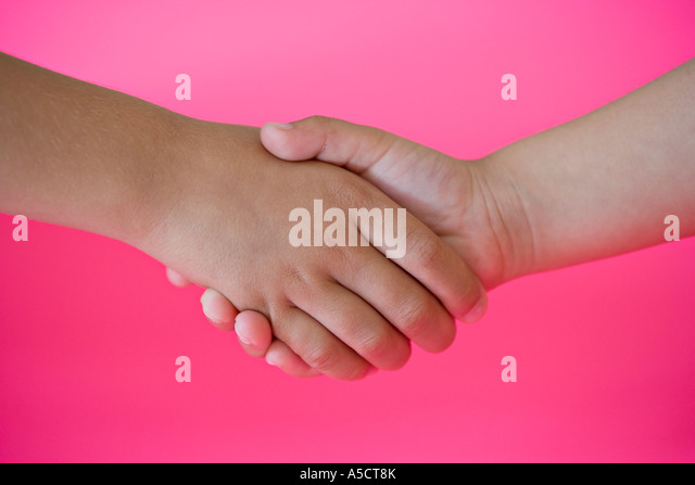 Children's hands with vibrant pink background - Stock Image