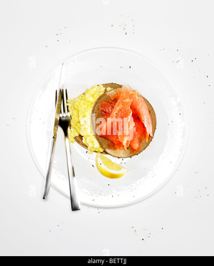 Pancake wraps with eggs and smoked salmon. - Stock Image
