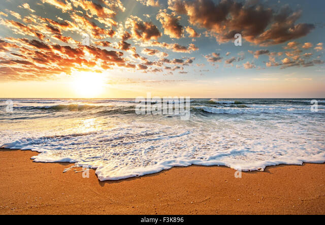 Brilliant ocean beach sunrise. - Stock Image