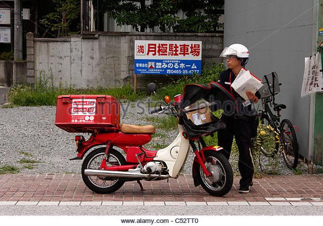 Postman sorting his delivery, Odawara, Japan - Stock Image