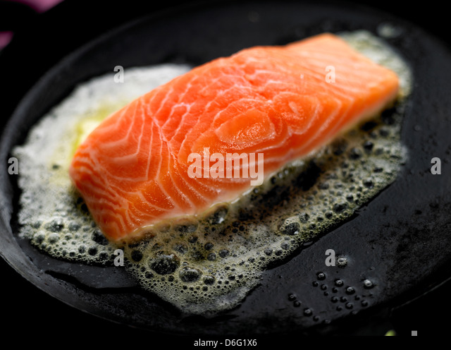 Searing Salmon in butter/ step shot - Stock Image