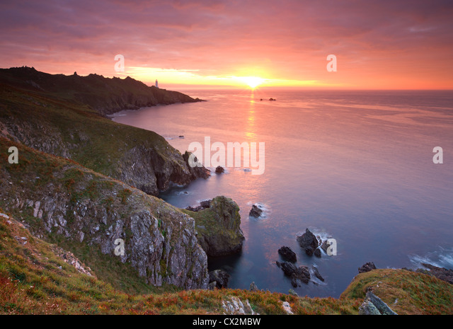 Spectacular sunrise behind Start Point Lighthouse in South Hams, Devon, England. Autumn (September) 2010 - Stock Image