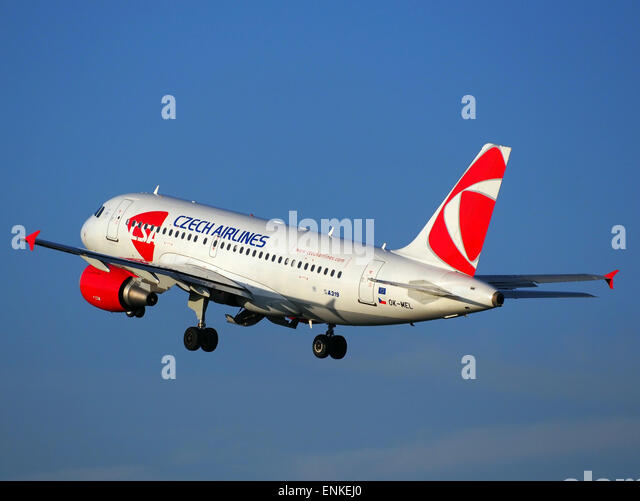 OK-MEL Czech Airlines (CSA) Airbus A319-112 - cn 3094 takeoff from Polderbaan, Schiphol (AMS - EHAM) at sunset, - Stock Image