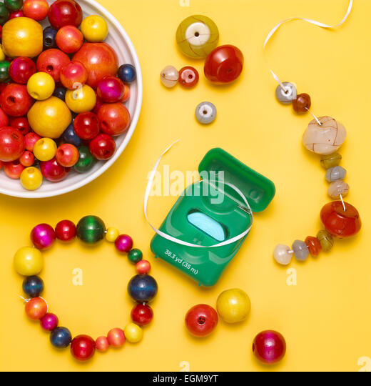 Beading With Dental Floss - Stock Image