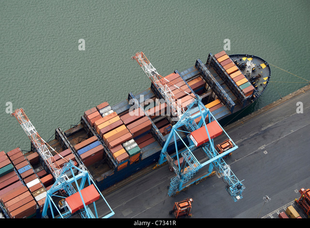 Container Ship Loading at Liverpool Docks, Liverpool, North West England - Stock Image