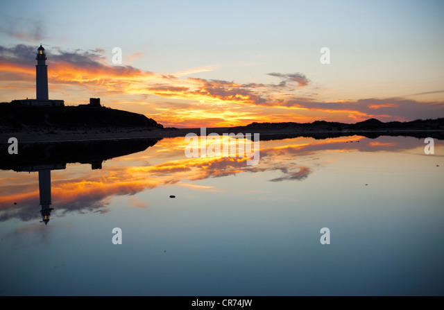 Spain, View of light house at dusk - Stock Image