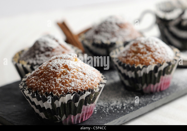 Carrot muffins with icing sugar - Stock Image