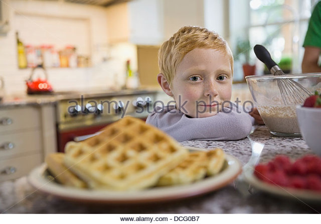 Portrait of little boy with breakfast - Stock Image